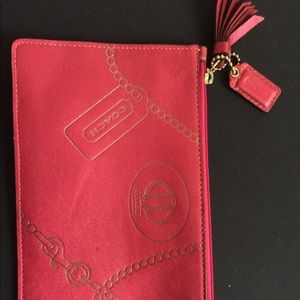 Coach beauty-bag-sized pouch printed with icons.